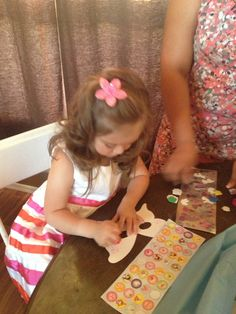 Perfect arts & craft for three year olds. Create their own masks, NO glue or glitter... Dozens of different types of stickers (foam, shiny, regular, etc), different stamp sets & crayons. they all LOVED it.  @Trish Wheelin  daughter is my model