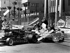 James Hunt of Great Britain and driver of the #1 MarlboroTeam McLaren M23 Ford V8 is launched into the air after hitting the rear wheel on the Martini Racing Brabham BT45 Alfa Romeo flat-12 of John Watson during the United States Grand Prix West on 3rd April 1977 at the Long Beach street circuit in Long Beach, California, United States.