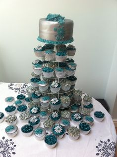 Teal and silver Wedding Cake + 80 cupcakes - This was my first time doing a wedding cake and cupcakes. I did choc fudge cake on top with 40 vanilla cupcakes with jam and 40 choc fudge cupcakes. Round Wedding Cakes, Purple Wedding Cakes, Wedding Cakes With Cupcakes, Birthday Cupcakes, Cupcake Cakes, Cupcake Wedding, Teal Cupcakes, Vanilla Cupcakes, Cupcake Ideas