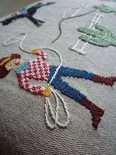 Cowboy cross-stitch upholstery....go pokes!