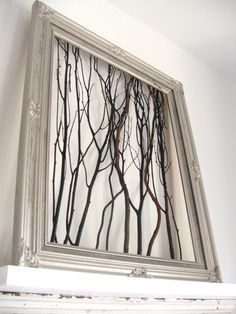 Twig picture - for Tori.  We used a rustic wooden frame & sticks from the front yard.  It looks awesome hanging over her bed.