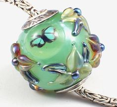 Yummy silver capped and cored butterfly floral bead.