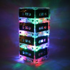 Light up any room with this totally unique and retro rainbow multi-color Cassette Tape Night Light Lamp.    16 Upcycled very rare blank cassette
