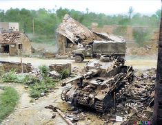 Pont-Farcy, Basse-Normandie, France, between the 3rd and the 5th of August 1944. A US Medical truck passes behind a wrecked Panzer IV Ausf. J medium tank of the 2nd Panzer-Division.
