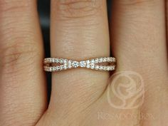 This gorgeous design is a spin off of infinity rings. This is designed so that it will sit fairly close to the straight engagement ring bands.…