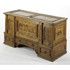 A South German oak, walnut and fruitwood marquetry chest first half 17th century with a rectangular moulded top above a central marquetry panel incorporating various architecture amidst a natural background flanked by two pairs of floral inlaid columns flanking marquetry niches above a central inlaid long drawer flanked by lower drawers. height 39 1/2 in.; width 6 ft. 3 in.; depth 30 in