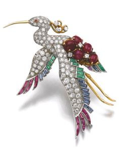 TWO GEM SET AND DIAMOND BROOCHES, ONE BY BULGARI One brooch designed as a heron, set with variously cut rubies, sapphires and emeralds, and pavé-set with brilliant-cut diamonds, signed Bulgari, one stone deficient; the other brooch designed as an eagle, set with brilliant-cut diamonds and circular-cut ruby eyes, may also be worn as a pendant.