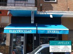 Instalación de 2 Toldos Brazo articulado A1 PREMIUM en tejido Standard Color BOMBAY, herrajes lacados en blanco y rotulado. Barriada La Paz (Málaga) 15/06/2016