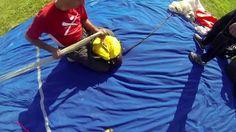 Flat packing a parachute