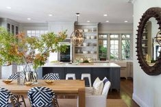 Many kitchen trends come and go but gray kitchens aren't going away any time soon and the kitchen you're about to see is not only the ultimate gray kitchen design but it also features the ultimate kitchen ideas! Kitchen Island Centerpiece, Kitchen Island Bench, Grey Kitchen Cabinets, White Cabinets, White Counters, Upper Cabinets, Grey Kitchens, Cool Kitchens, Grey Kitchen Designs