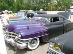 Classic with flat black, purple flames, white-wall tires, pinstriping, and a chopped top.....a dream come true!