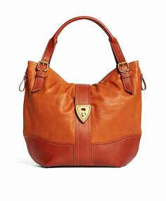 Shrunken Leather Large Hobo Bag Cognac by Brooks Brothers.  I purchased mine from HSN in this cognac color. Top value of the day 3/14/13 & they have white and black with the darker cognac base color. $200 off if you order from HSN, exaxt same bag, I thoroughly checked prior to ordering this as my Easter gift. ;)
