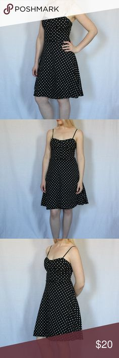 "FOREVER Polka Dot A-line Dress Super cute, pre-loved polka dot A-line dress from Forever. This is a really fun and flirty dress that's perfect for summer days out! Design includes 2 small loops on the side for a skinny belt, zips up from the back, and has 6 decorative buttons in front.  97% Cotton, 3% Span Length: 29"" Bust across: 14.5"" Waist across: 12"" Forever 21 Dresses Mini"
