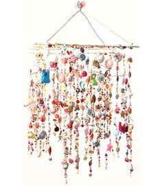 Hee!  I could totally use up all my extra beads and bling to make something like this to hang over my porch light,