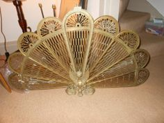 Vintage peacock fire screen