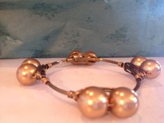 Handmade wire wrapped gold pearls antique brass bracelet  on Etsy, $20.00