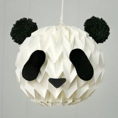 Turn your white paper lanterns into a cute panda, with 2 pompoms and a template!