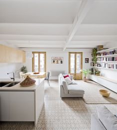 open space, serene, tiles, balcony doors, long shelves  low storage