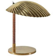 """Paavo Tynell Rare Desk Light, """"Simpukka"""" (Clam) Finland, ca. 1940s Brass, cane-wrapped metal. 27 h x 22.86 w x 22.86 d cm 10.5 h x 9 w x 9 d inches Underside impressed TAITO"""