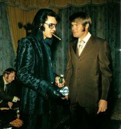 ELVIS PRESLEY in the Jungle Room at Graceland, with Country Music singer GLEN CAMPBELL...
