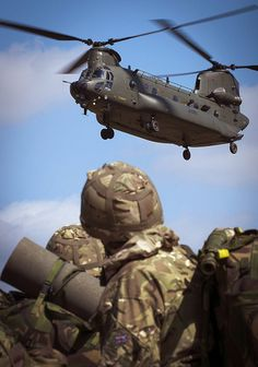 Members of RAF Benson Puma Force prepare to depart from the Bramley training area by Chinook helicopter as part of Exercise Tigerheart.