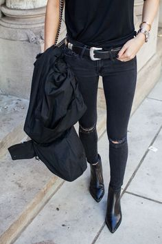 black total look. Black leather boots. Black trousers, and black leather belt.