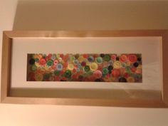 Another one of my mums creations with an old frame and colourful buttons :)