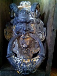 Original large cast iron door knocker, horned demon or Pan. circa late 19th century--I want a doorknocker like this!