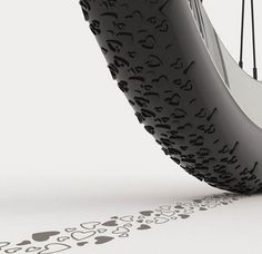 A bicycle tire with heart-shaped treads, so it will leave a trail of hearts as you ride.