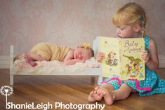 newborn & sibling photography pose. bed & book