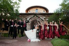 Red bridesmaid dresses and groomsmen in matching ties and vests | villasiena.cc