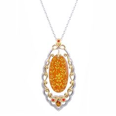 This 18-karat yellow gold vermeil two-tone necklace will add a beautiful sparkle to any outfit. This necklace features amber, citrine, orange sapphires, and fire citrine gemstones. The spring ring clasp keeps this 18-inch necklace secure.