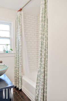 DIY bathroom redo -Double Shower Curtain, subway tile with grey grout, the wood floors (could do the tile that looks like wood)