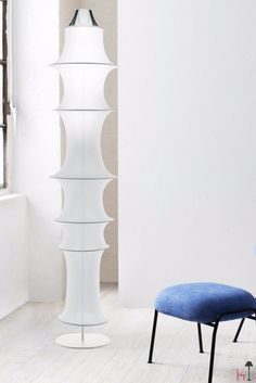 This table lamp is designed by Bruno Munari for Danese Milano.