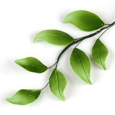 Green gumpaste leaves sugarflowers perfect for cake decorating fondant cakes and complimenting with sugarflowers. | CaljavaOnline.com #caljava #gumpaste #sugarflower