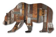 In the Woods Collection by Dolan Geiman. Salvaged metal and found objects create an intriguing and richly textured surface in the shape of a strolling bear. Each is truly one of a kind, created from a unique set of recycled materials that will vary widely. Wood backing. Signed and dated on back. Ready to hang. This made-to-order art collection will vary according to the current inventory of rescued supplies. If you are interested in adding personal touches, such as colors, names, or numbers…