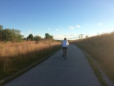 Becky and I take short sunset rides along the Eagle Creek Trail  ear hour home on Indy's northwest side.