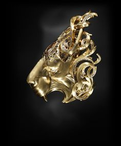 Jack du Rose Lion in yellow gold, cognac, champagne and white diamond, and caramel sapphire; the lion is a symbol of strength, and of the zodiacal sign of Leo.