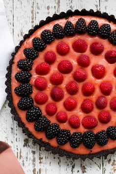 Triple-citrus tart with chocolate crust and berries. This elegant citrus tart is made with a dark chocolate wafer crust and filled with blood orange, lemon, and lime curd. Tart Recipes, Sweet Recipes, Pie Dessert, Dessert Recipes, Citrus Tart, Good Pie, Chocolate Wafers, Shortcrust Pastry, Sweet Pie