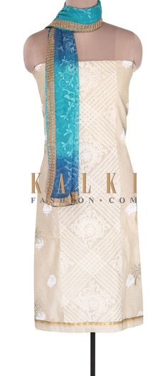Buy Online from the link below. We ship worldwide (Free Shipping over US$100). Product SKU - 305782.Product Link - http://www.kalkifashion.com/cream-unstitched-suit-adorn-in-lucknowi-embroidery-only-on-kalki-18538.html