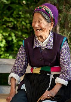 Buddhist woman taking a break from spinning the largest prayer wheel in Asia. Zhongdian (Shangri La) China, 2011