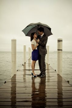 Making the most of a rainy engagement shoot :) - http://www.flickr.com/photos/meganlucy/