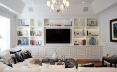 Aubrey & Lindsay's Little House Blog. love how the pattern on the doors carries around on the side wall, and how the framed print echos the look of the tv to take the emphasis off it