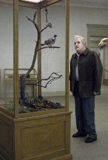 Eine Taube sitzt auf einem Zweig und denkt über das Leben nach (2014) Poster