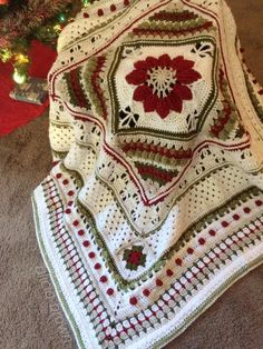 Christmas Charlotte meets ATB! Sooo pleased with how this came out and how pretty it looks on my sofa! Dedri Uys and ChiChi Allen for sharing these lovely patterns with us!!  Yarn used - Vanna's Choice in White, Cranberry, Linen, Dusty Green and Olive Patterns: Charlotte Square by Dedri Uys - http://www.lookatwhatimade.net/…/a-new-large-square-in-a-b…/ ATB Border by ChiChi Allen - http://www.ravelry.com/patterns/library/atb-border-tutorial Around the Bases CAL (through part of inn