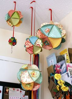 A twist on the pom poms. Paper circles with an equilateral triangle in the middle. Fold along triangle and glue together edges. by kim