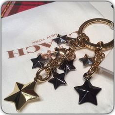 Coach Stars Keychain Gold and Charcoal Colors. Coach Star Keychain. New with tags. Comes with dust bag and Coach Bag. Coach Accessories Key & Card Holders