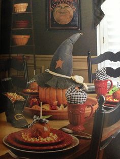 Fall decor table; (I, like pumpkins with witches hats; and, the carmel-apple is, 'eye-candy'; for, openers! JH)