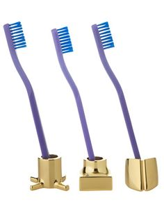 Stands plated in 18-karat gold are a chic alternative to the ordinary toothbrush tumbler. Fits most razors, too.