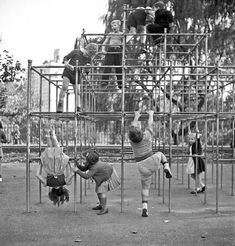 New York. Janet and Marie Wynn (lower left), Czech-American children, climbing on monkey bars in Central Park playground, 1942
